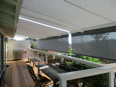 View from the balcony of the retractable awning on the San Carlos home with shades down