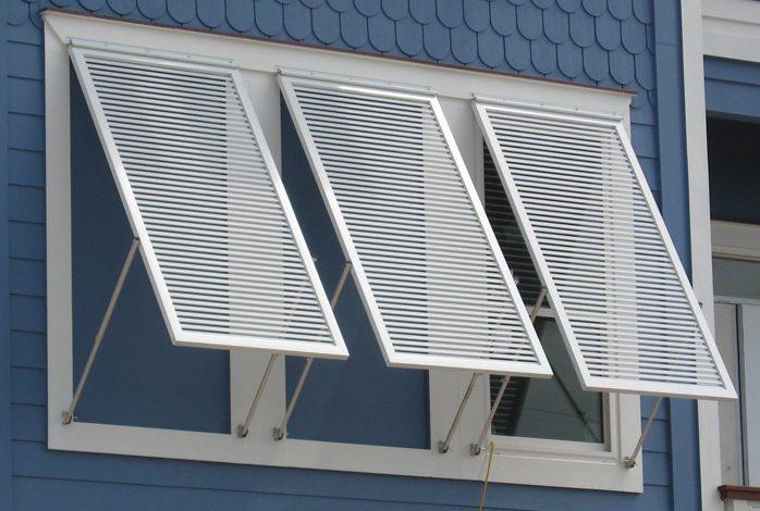 Bahama shutters with aluminum construction