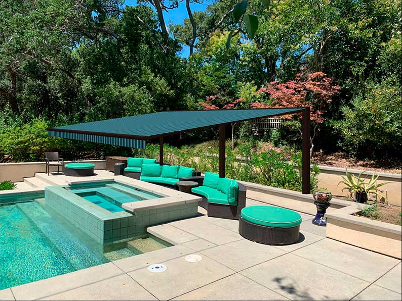 Poolside sitting area with a retractable awning concept
