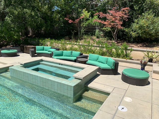 Poolside sitting area with variable shade