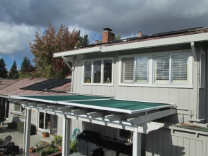 Retractable Pergola Cover Extended in Bad Weather
